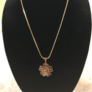 Goldtone necklace with flower